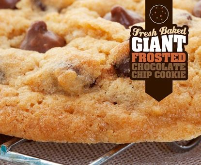 fresh baked giant frosted chocolate chip cookie